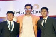Hrithik Roshan (C), owner of FC Pune team with players Jackichand Singh and Eugeneson Lyngdoh