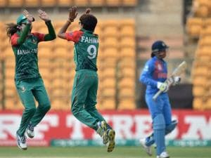 Bangladesh's Fahima Khatun with team mates celebrates the wicket of S Mandhana of India during the ICC Women's World T20 match at Chinnaswamy