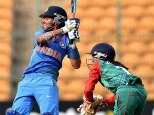 India's Harmanpreet Kaur plays a shot during the ICC Women's World T20 match against Bangladesh at Chinnaswamy Stadium