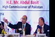 Pakistani High Commissioner, Abdul Basit is greeted by Chairman of ASSOCHAM's India -SAARC business promotion council Ravi Wig