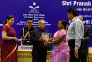 President Pranab Mukherjee with HRD Minister Smriti Irani persenting Literacy Awards