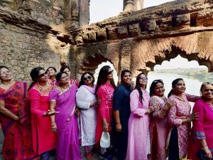 Women on a tour of the Rani Kamlapati Mahal in Bhopal on the eve of International Women's Day