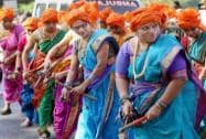Women perform Lezim folk dance during Shiv Jayanti