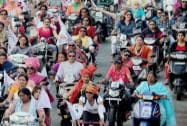 Women take part in a bike rally during International Women's Day