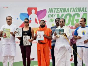 Bipasha Basu performs yoga postures during the 2nd International Yoga day