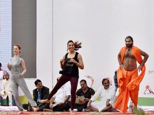 Swami Vachanananda and Bipasha Basu performing yoga exercises