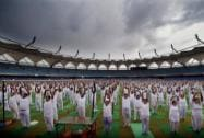 Participants take part in a yoga during the practice session of International Day of Yoga Rehersal Camp