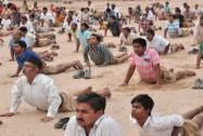 RSS activists take part in a Yoga practice
