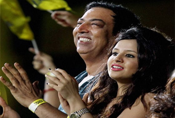 **FILE** Actor Vindoo Dara Singh with Chennai Super Kings Skipper MS Dhoni's wife Sakshi watches an IPL T20 match in Chennai in April 2013
