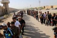 Iraqi men line up to volunteer for military service