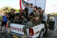 Iraqi Shiite tribal fighters chant slogans