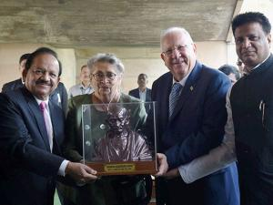 Israeli President Reuven Rivlin and his wife Nechama Rivlin are presented with a bust of Mahatma Gandhi