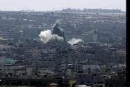 Smoke and dust rise after an Israeli strike hits in Gaza City