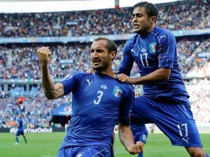 Italy's Giorgio Chiellini, left, celebrates with Eder