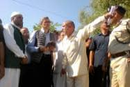 J K CM Omar Abdullah during a visit to flood affected