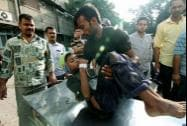 An injured being taken to the Government Medical College Hospital
