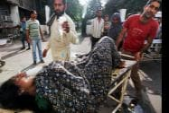 An injured woman being taken to the Government Medical College Hospital