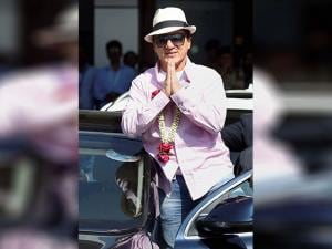 Jackie Chan greets the crowd as he arrives at the airport in Mumbai to promote his upcomming film ' Kung FU Yoga'