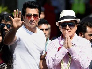 Jackie Chan with actor Sonu Sood greets the crowd as he arrives at the airport in Mumbai to promote his upcomming film ' Kung FU Yoga'