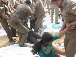 Policemen detain students who were holding a protest demanding a permanent solution for holding the Jallikattu, in Coimbatore