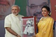 Prime Minister Narendra Modi greets  to crowd as actress and BJP MP Hema Malini