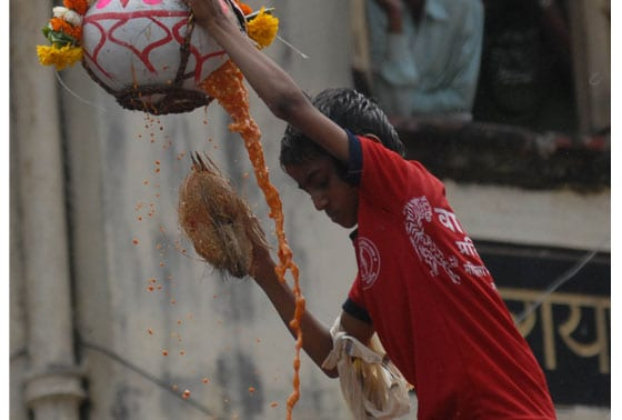 A young boy celebrating Dahi Handi during Janmashtami in Mumbai on Wednesday