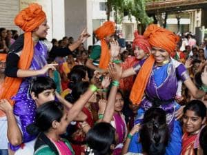 Students from a girls college celebrate Dahi Handi festival