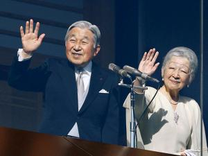 Japan's Emperor Akihito and Empress Michiko wave to well-wishers