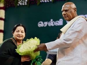 Tamil Nadu Governor K Rosaiah greets AIADMK supremo J Jayalalithaa after administering her oath as the State Chief Minister at Madras University Centenary Auditorium in Chennai