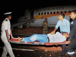 An injured passenger is carried for treatment