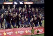 Barcelona players pose for a team photo with the Joan Gamper trophy after defeating Leon following the Joan Gamper trophy friendly soccer match
