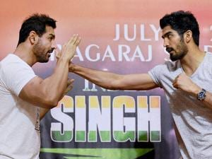 John Abraham and Vijender Singh during a promotional event
