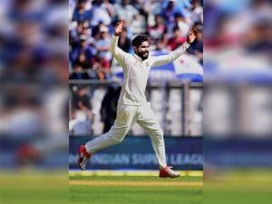 Ravindra Jadeja celebrates the wicket of Jos Buttler