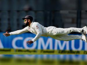 Virat Kohli  dives to field the ball