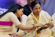 West Bengal Chief Minister Mamata Banerjee with Tollywood actress June Maliah