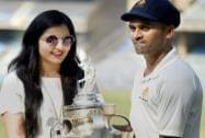 Karnataka Captain, Vinay Kumar holds the Ranji Trophy along with his wife Richa