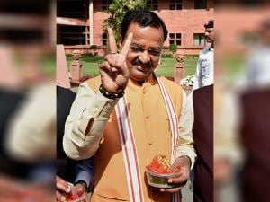 Uttar Pradesh BJP President and party MP Keshav Prasad Maurya flashes victory sign