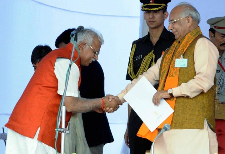 Haryana Governor, Kaptan Singh Solanki, greets, newly sworn-in, Chief Minister, Manohar Lal Khattar