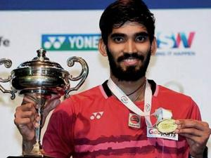 Shuttler Kidambi Srikanth poses with the trophy after winning the Australian Open Super Series title