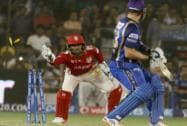 Wriddhiman Saha of Kings XI Punjab takes the bails off to get Shane Watson
