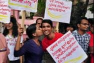 A girl kisses a boy as a support to 'Kiss of Love'  protest rally