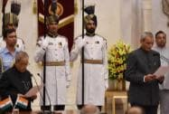 President Pranab Mukherjee greets newly sworn-in Central Vigilance Commissioner KV Chowdary