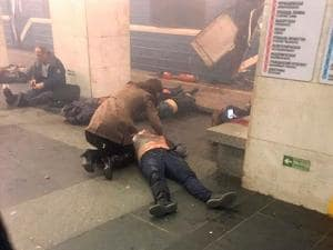 Blast victims lie near a subway train hit by a explosion at the Tekhnologichesky  subway station in St.Petersburg