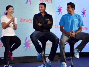 Mary Kom speaks as Mahesh Bhupathi and Rohan Bopanna look on during the launch of Zeven sports brand in New Delhi