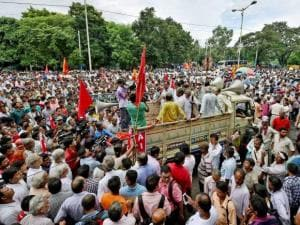 Left Front supporters march to state secretariat to protest against farmer suicides