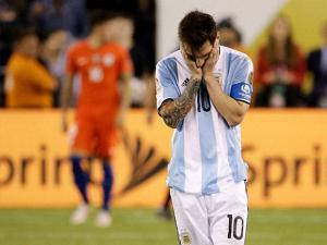 Argentina's Lionel Messi reacts after missing his shot during penalty kicks in the Copa America