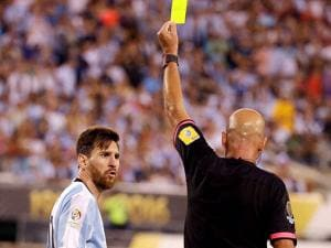 Referee Heber Lopes of Brazil gives Argentina's Lionel Messi a yellow card during  Copa America 2016