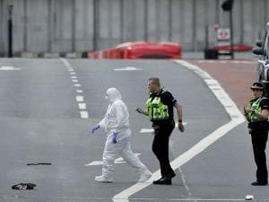 Forensic police work within a cordoned off area after an attack in the London Bridge area