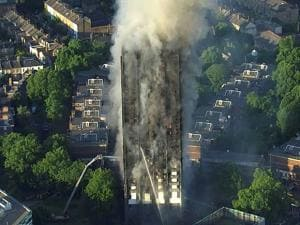 smoke rises from a high-rise apartment building