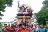 Devotees carrying idols during a Ganpati Visarjan procession